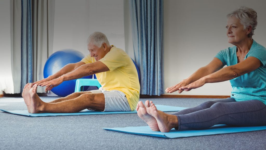 Elderly people doing a pilates class